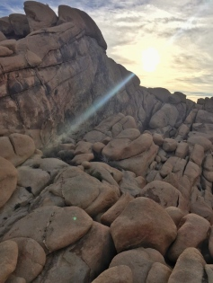 hazy sun over the rocks