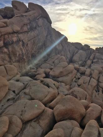 hazy sun over the rocks